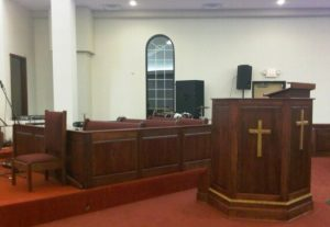 wooden pulpit with gold crosses