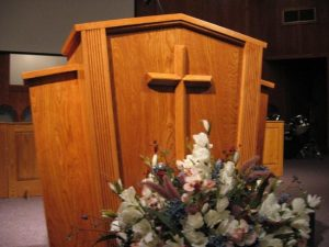 wooden pulpit with cross