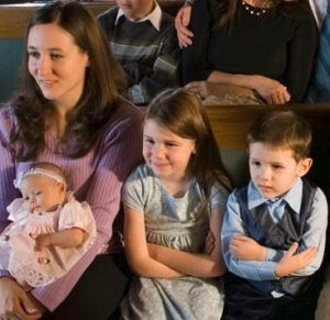 family sitting in pew