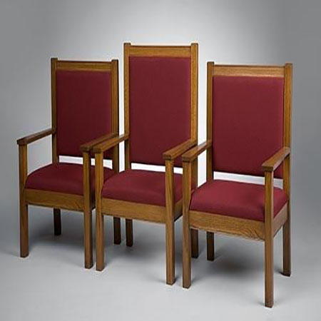 Three wooden church chairs with red cushions