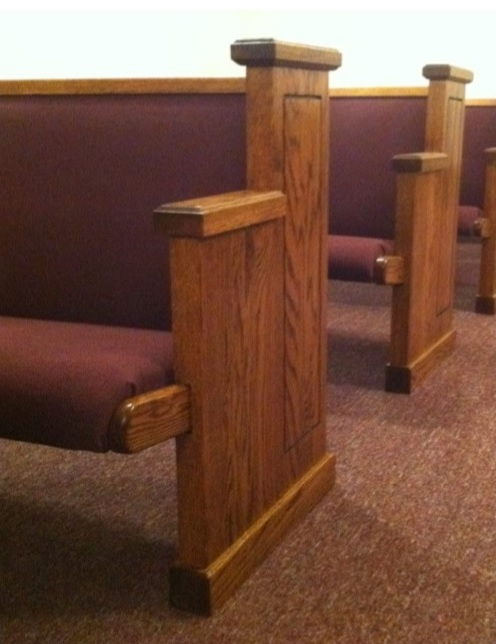 Wooden church pews in a row