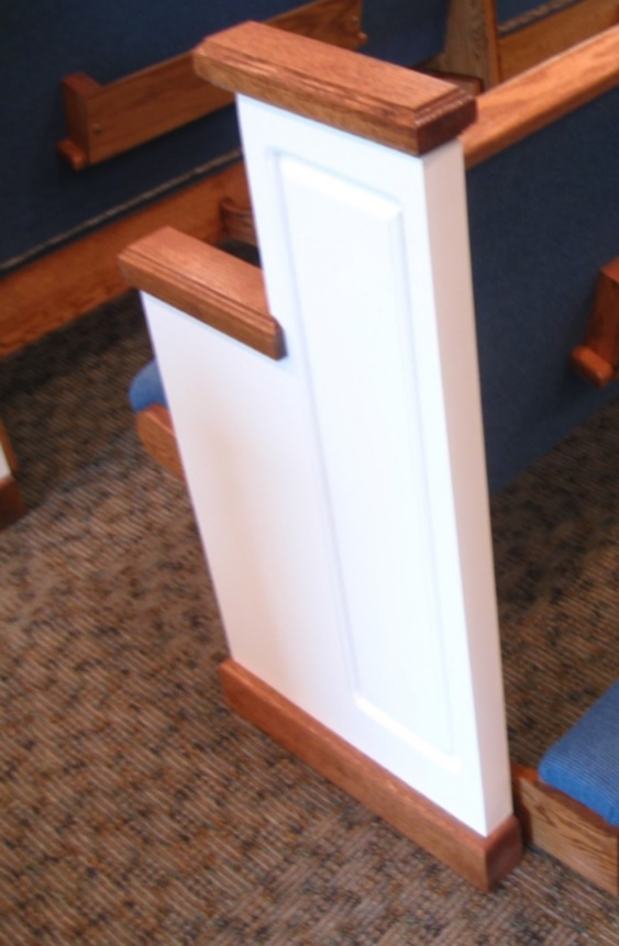 Wooden church pew end painted white
