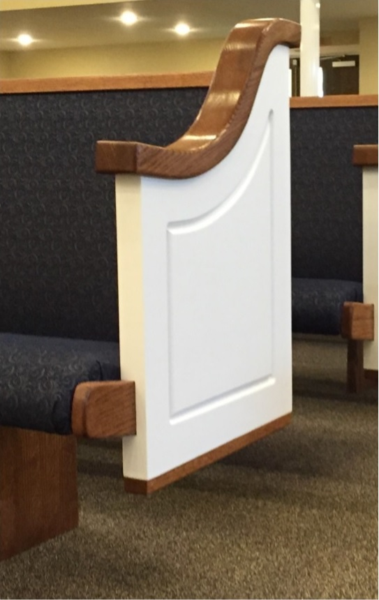 Wooden pew ends painted white